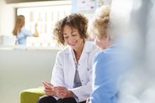 Pharmacist explaining medication to patient
